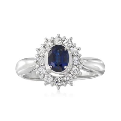 C. 1990 Vintage .69 Carat Sapphire and .43 ct. t.w. Diamond Halo Ring in Platinum