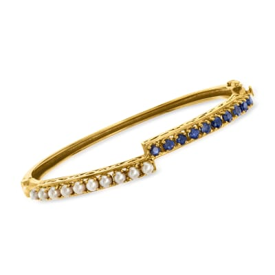 C. 1970 Vintage Cultured Pearl and 1.50 ct. t.w. Sapphire Bypass Bangle Bracelet in 14kt Yellow Gold