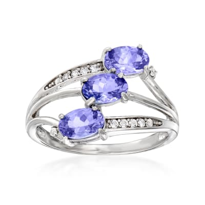 1.00 ct. t.w. Tanzanite and .10 ct. t.w. White Topaz Three-Stone Ring in Sterling Silver