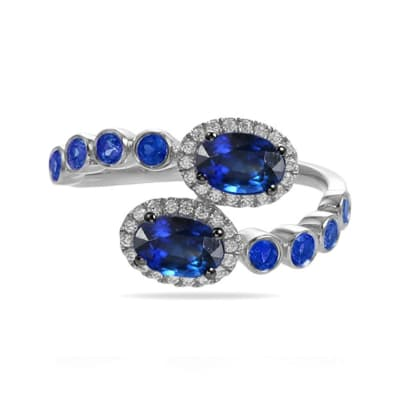 1.70 ct. t.w. Sapphire and .15 ct. t.w. Diamond Bypass Ring in 18kt White Gold