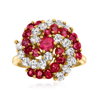 C. 1980 Vintage 1.80 ct. t.w. Ruby and 1.20 ct. t.w. Diamond Swirl Ring in 14kt Yellow Gold