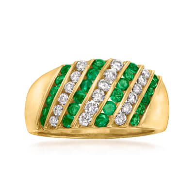 C. 1980 Vintage .61 ct. t.w. Emerald and .45 ct. t.w. Diamond Diagonal-Row Ring in 18kt Yellow Gold