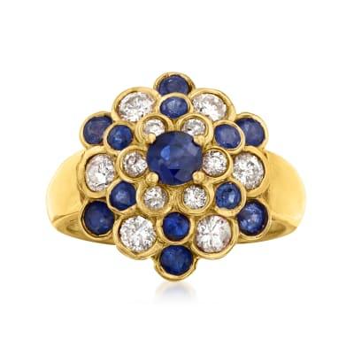 C. 1980 Vintage 1.20 ct. t.w. Sapphire and .75 ct. t.w. Diamond Cluster Ring in 18kt Yellow Gold