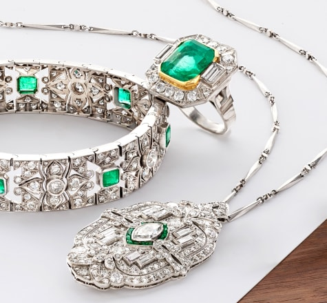 Estate Treasures. Image of emerald and diamond bracelet, ring and pendant necklace.