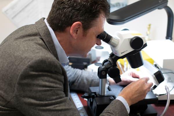 Gemologist looking at gemstones
