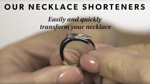 Necklace shortener YouTube video. Fingers holding necklace shortener.