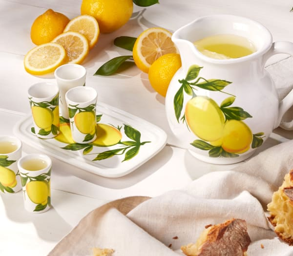 Direct from Italy. Give your space a Mediterranean spin. Image of lemon design pitcher and glasses.