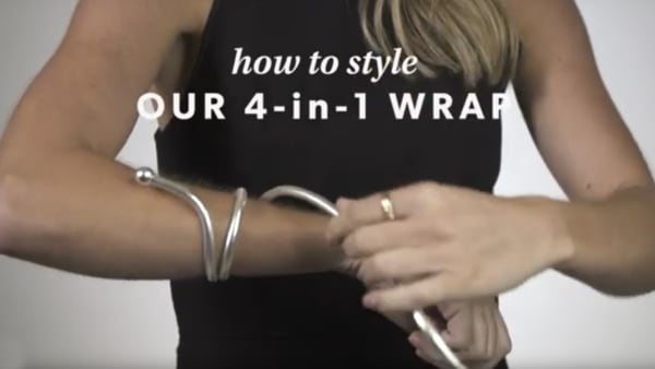 Four-in-one jewelry YouTube video. Model showing how to style.