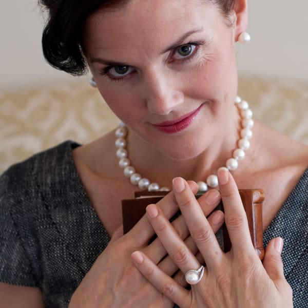 Pearl earrings, ring and necklace.