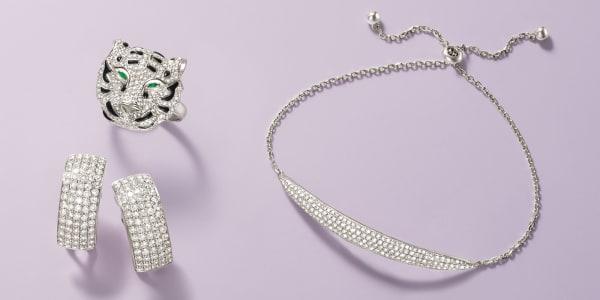 Diamond earrings, lion-head ring and bracelet.