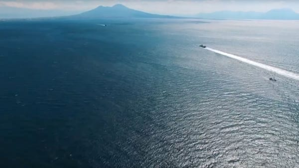 Italian cameo YouTube video. Vast sea with boats and island in distance.