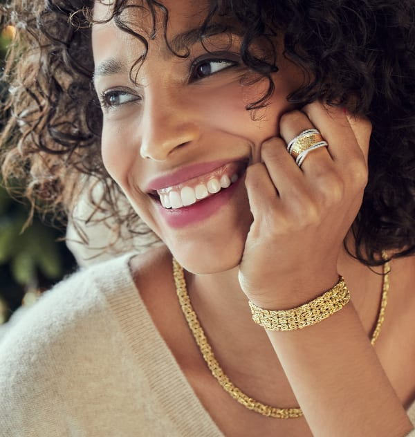 Timeless Gifts. Image featuring model shot wearing gold necklace and bracelet