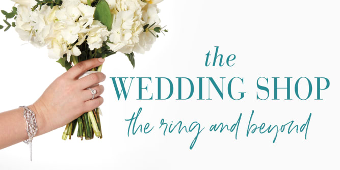 The Wedding Shop. The ring and beyond. White flowers wrapped strand of pearls
