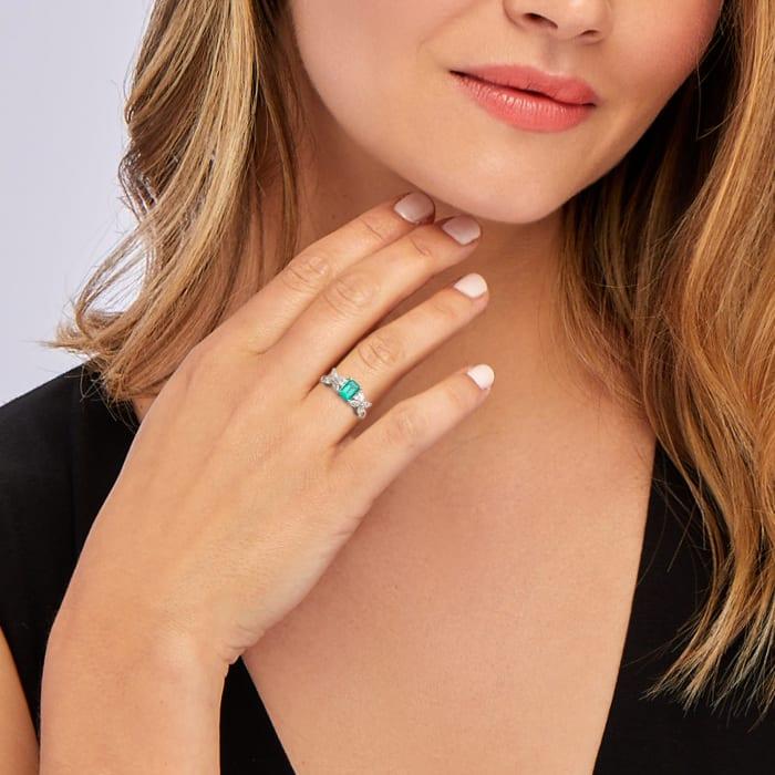 C. 1980 Vintage .75 Carat Emerald and .80 ct. t.w. Diamond Ring in Platinum