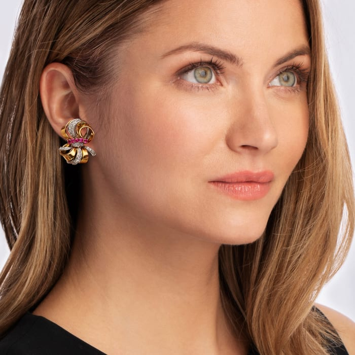 C. 1960 Vintage 1.50 ct. t.w. Ruby and 1.20 ct. t.w. Diamond Bow Clip-On Earrings in 18kt Yellow Gold