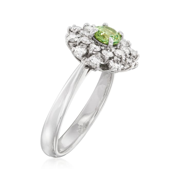 C. 2000 Vintage .52 Carat Green Tourmaline and .60 ct. t.w. Diamond Cluster Ring in Platinum