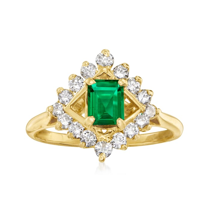 C. 1980 Vintage .55 ct. t.w. Diamond and .35 ct. t.w. Emerald Ring in 18kt Yellow Gold