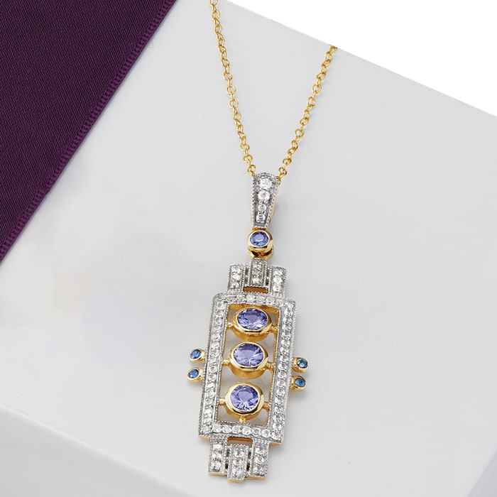 .70 ct. t.w. Tanzanite and .70 ct. t.w. White Zircon Pendant Necklace in 18kt Gold Over Sterling