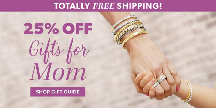 Totally Free Shipping! 25% Off Gifts For Mom. Shop Gift Guide. Image Featuring Mom Holding Hands With Her Daughter, Both Wearing Bracelets and Rings