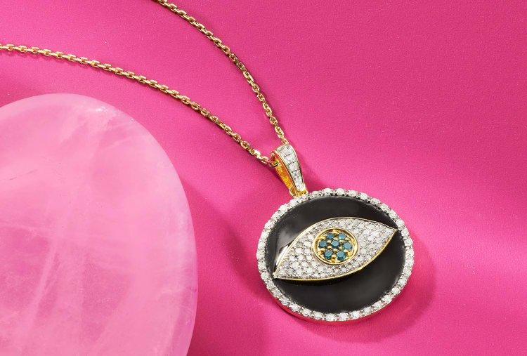 blue and white diamond evil eye pendant with black enamel
