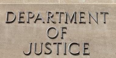 Lambert takes aim at DOJ prosecution