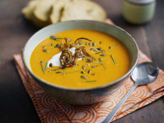 Shallot, Pumpkin and Red Pepper Soup with Candied Shallot and Pumpkin Seeds served with Low Fat Crème Fraiche