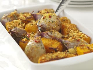 Baked pumpkin and shallots with a crispy rosemary, chilli, orange and olive oil breadcrumb topping