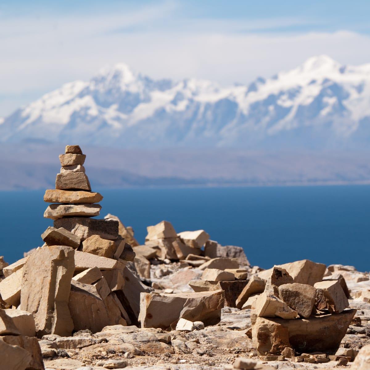 Rock pyramid, Lake Titicaca and Bolivian mountains