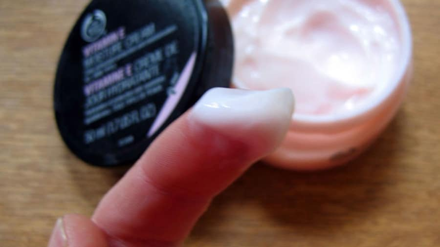 pink moisturizer on finger for keratosis pilaris