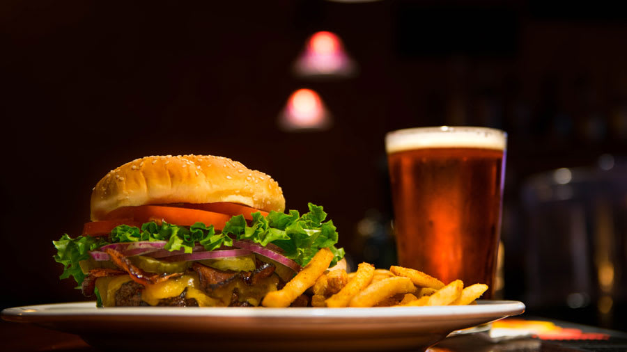 Red meat hamburger and alcohol on a table