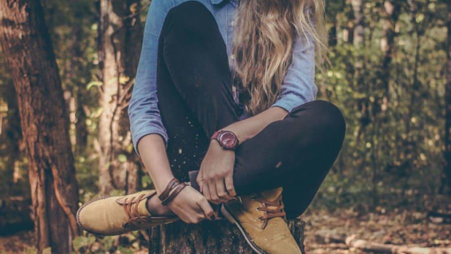 woman sitting cross legged outdoors