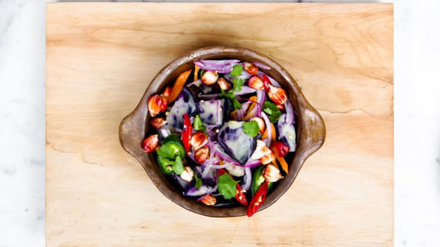 ​healthy colorful salad with red corn hot peppers sweet peppers purple potatoes red onions cilantro