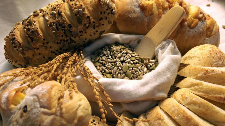 Multiple grains and breads spread out