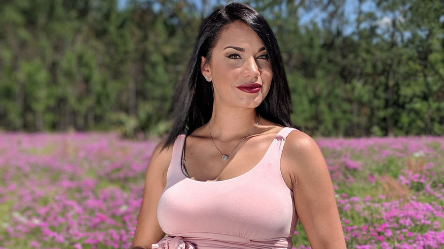 Pregnant woman in pink in flower meadows