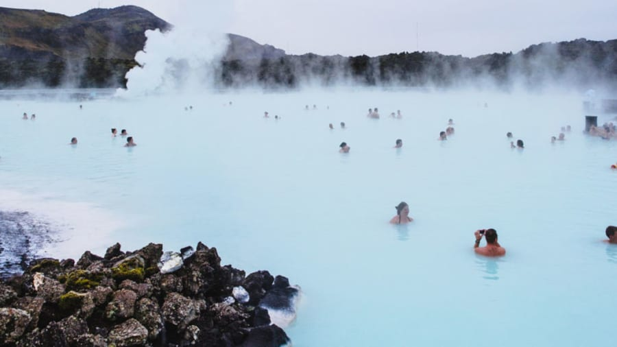 people bathing in hot springs