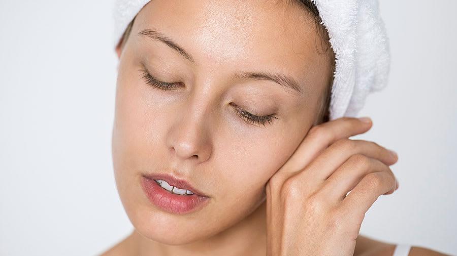 woman treating facial acne