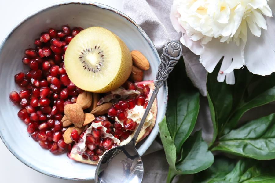 bowl of antioxidant fruits with silver spoon