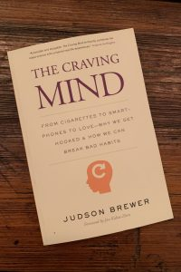 book cover of The Craving Mind: From Cigarettes to Smartphones to Love—Why We Get Hooked and How We Can Break Bad Habits