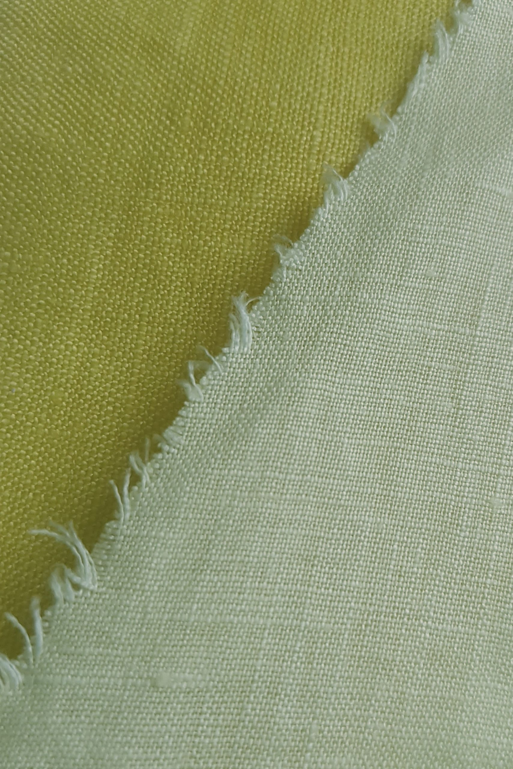 close up of linen hand dyed shades of sunflower yellow