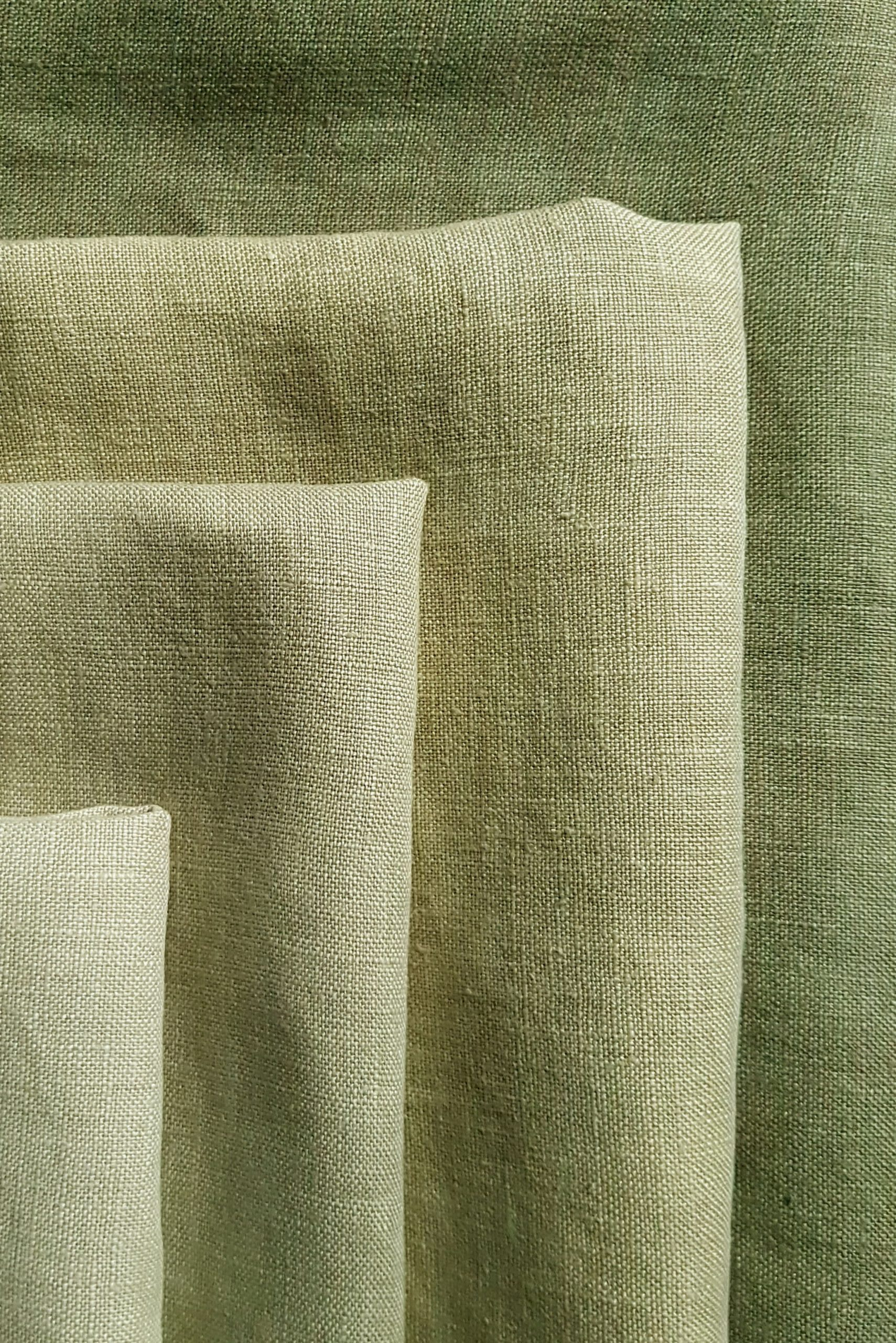 close up of linen hand dyed shades of Dylon Olive Green
