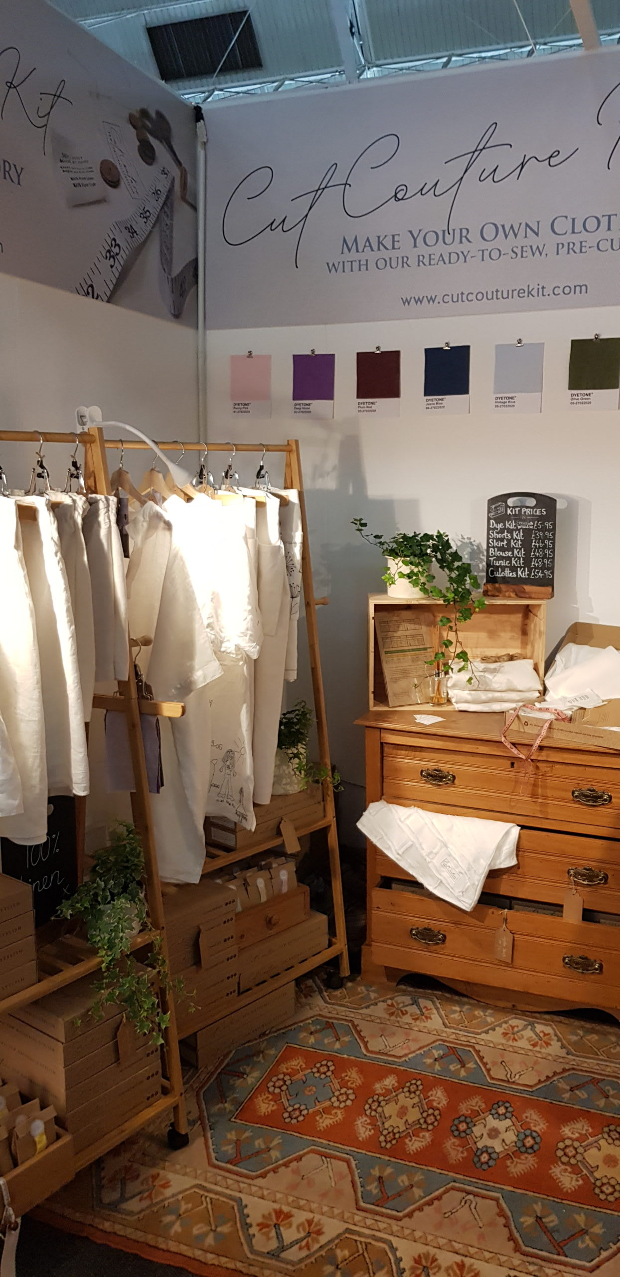 linen clothes on a rail, pine drawers