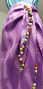 a purple skirt with beaded edge