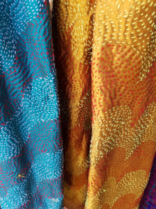 Hand stitched colourful textiles