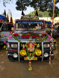 a car with garlands in india