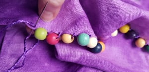 sewing beads to a skirt edge
