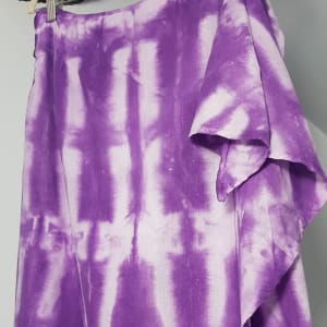 A purple tie dyed skirt