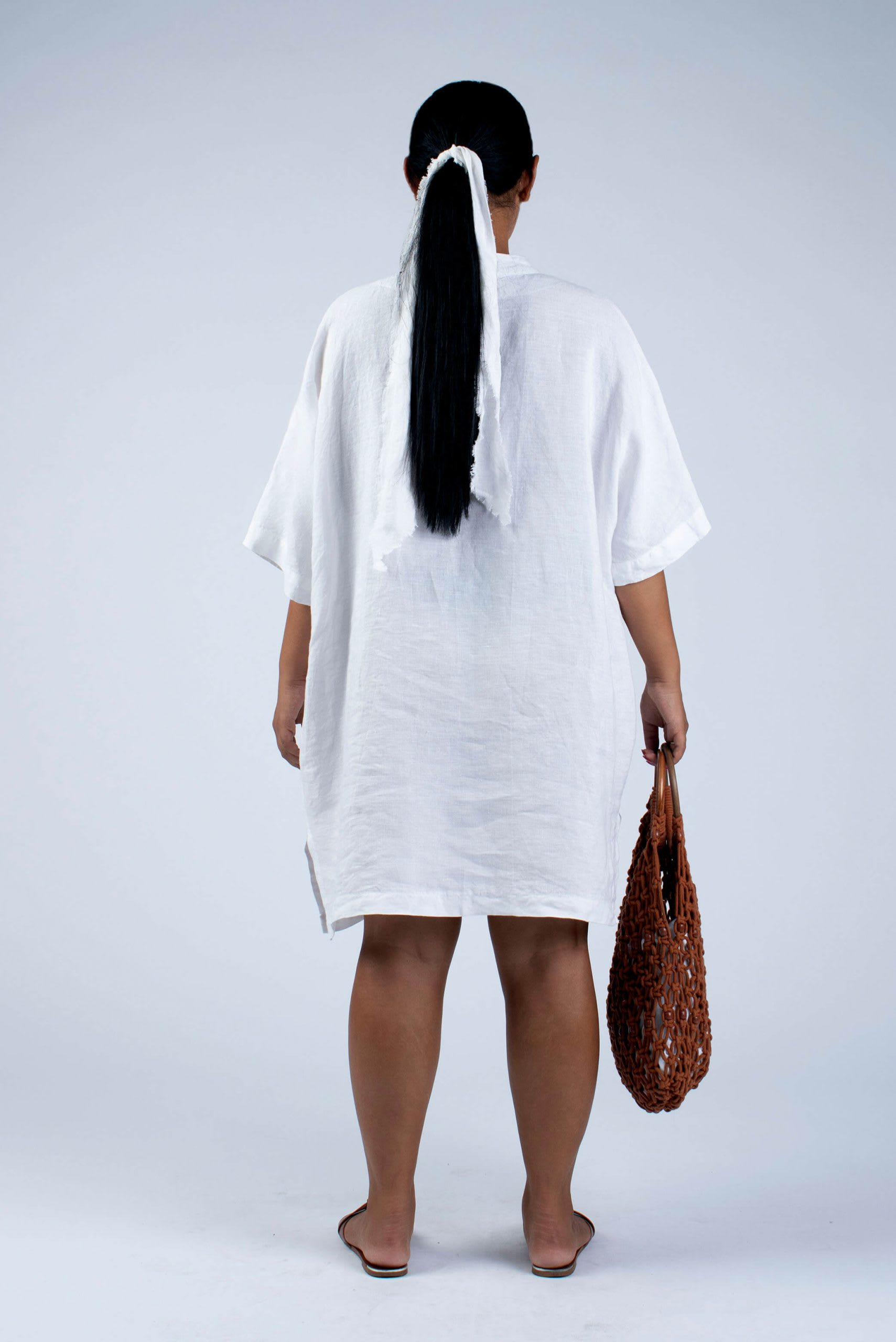 back view of Cut couture Helen white linen tunic