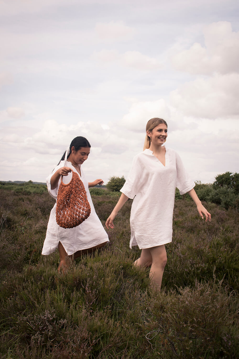 models in white linen tunics New Forest