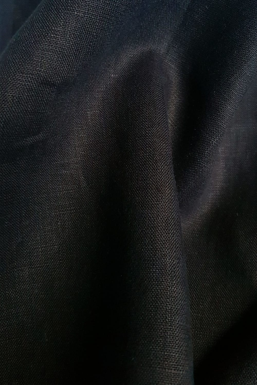 close up of black hand dyed linen