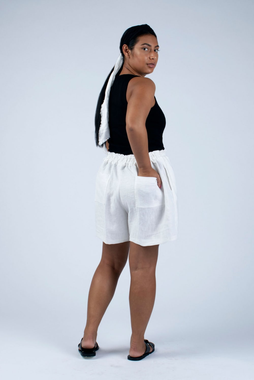 back view of Kathy white linen shorts